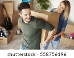 couple carrying heavy moving... | Shutterstock . vector #558756196