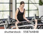 trainer woman helping athletic... | Shutterstock . vector #558764848