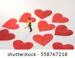 miniature couple standing with... | Shutterstock . vector #558767218