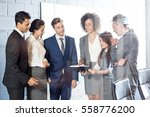 businesspeople looking in diary ... | Shutterstock . vector #558776200