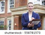portrait of female realtor... | Shutterstock . vector #558781573