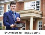 male realtor standing outside... | Shutterstock . vector #558781843