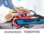 female hands packing traveler... | Shutterstock . vector #558809548