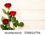 Stock photo  red roses on white aged table 558816796