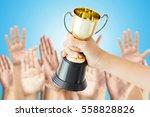 winner of voting hand holding... | Shutterstock . vector #558828826