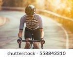 asian men are cycling road bike ... | Shutterstock . vector #558843310