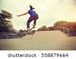 young skateboarder practice... | Shutterstock . vector #558879664