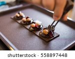 closeup chef's hand decorate... | Shutterstock . vector #558897448