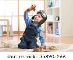happy child toddler boy playing ... | Shutterstock . vector #558905266