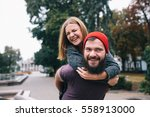 a loving couple walking on the... | Shutterstock . vector #558913000