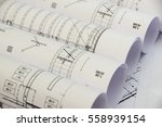 Small photo of Floor plan designed building on the drawing - background. Architect rolls and plans