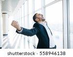 businessman raising fist and... | Shutterstock . vector #558946138