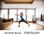 young woman exercising at home  ... | Shutterstock . vector #558956290