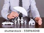 man holding an umbrella... | Shutterstock . vector #558964048