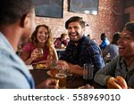 friends eating out in sports... | Shutterstock . vector #558969010