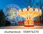 rotating illuminated attraction ...   Shutterstock . vector #558976270