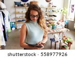 female business owner using... | Shutterstock . vector #558977926