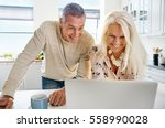laughing attractive middle aged ... | Shutterstock . vector #558990028