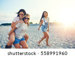 three beautiful girls having... | Shutterstock . vector #558991960