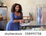 mixed race woman working in... | Shutterstock . vector #558995758