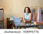 young woman working in clothes... | Shutterstock . vector #558995770