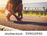 handsome man running on road...   Shutterstock . vector #559010950