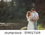 the bride and groom in nature.... | Shutterstock . vector #559017109