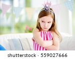 moody little girl wearing... | Shutterstock . vector #559027666