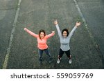 two urban sporty women with... | Shutterstock . vector #559059769