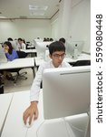 Small photo of Bangkok, Thailand - November 17, 2015 : King Mongkut's Institute of Technology is a research and educational institution A class of students in front of their screens study computer science.