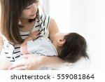mother and her baby | Shutterstock . vector #559081864