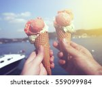 young couple holding ice cream... | Shutterstock . vector #559099984