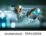 senior male researcher carrying ... | Shutterstock . vector #559110034