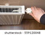 hand on heater | Shutterstock . vector #559120048