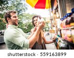 couple buying a hot dog in a... | Shutterstock . vector #559163899