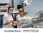 dentist in a private office... | Shutterstock . vector #559170220
