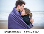 Couple In Blanket On The Sea...