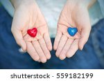 Two Small Red And Blue Heart O...