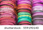 colored bracelets woven from... | Shutterstock . vector #559190140