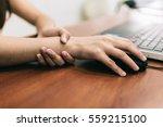 woman holding her wrist pain... | Shutterstock . vector #559215100