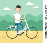 young bearded guy riding a bike ... | Shutterstock .eps vector #559226194