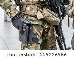 Modern Army man with hand holding a gun