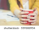 businesswoman holding red cup... | Shutterstock . vector #559300954