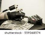hand of tattoo artist holding... | Shutterstock . vector #559368574