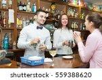 bartender and smiling barista... | Shutterstock . vector #559388620