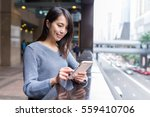 woman using cellphone at outdoor | Shutterstock . vector #559410706