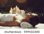 massage. beautiful girl in spa... | Shutterstock . vector #559432300