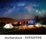 rear view couple hikers holding ... | Shutterstock . vector #559509598