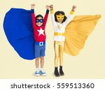 superhero kids hands up flying... | Shutterstock . vector #559513360