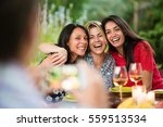 three beautiful women posing... | Shutterstock . vector #559513534